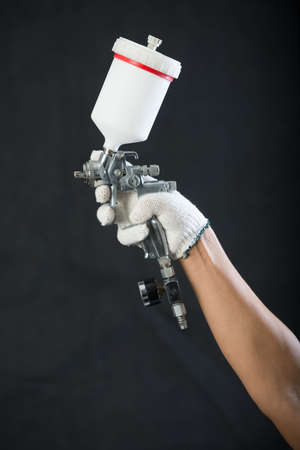 spay: air brush in hand Stock Photo
