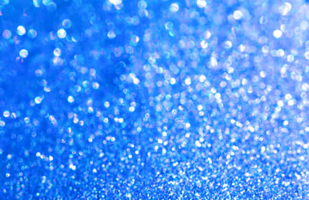 Blue glitter texture christmas abstract background. Shiny wrapping paper texture, greeting card design element
