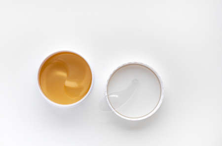 Gold energy hydrogel eye patch. Modern cosmetic concept. Anti aging and lifting. Facial skin care. Moisturizing the skin. Top view with copy space. Standard-Bild