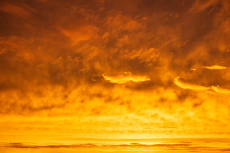 Orange sky Colorful sunset. Flaming orange clouds after rain. Abstract background.