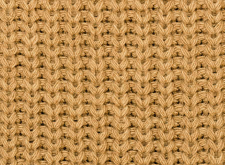Knitted fabric texture in autumn color. Close-up. Abstract background. Archivio Fotografico