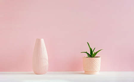 Geometric composition of pink ceramic vases. The concept of minimalism. The decor of the interior.