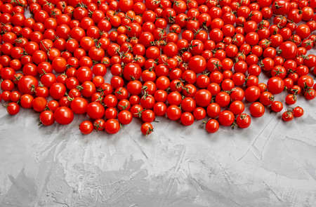 Cherry tomato pattern on a gray background. top view. Copy space.