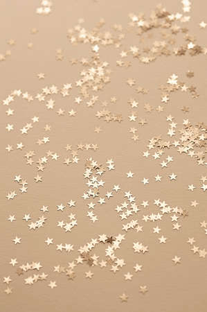 Festive abstract background. Golden decorative stars. Selective focus.