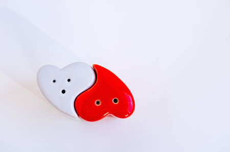 Heart shaped kitchen utensils for salt and pepper. Ceramic salt and pepper shaker.