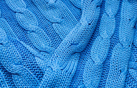 Knitted texture in blue. Background for a holiday card. Close up. Фото со стока