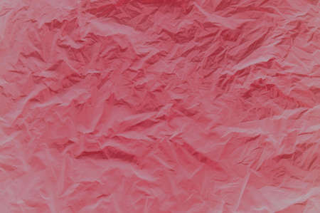 Abstract background. Crumpled fabric in red. Background image of crumpled fabric.