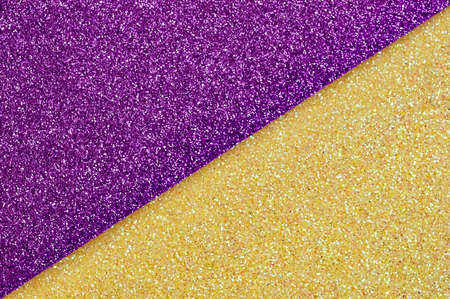 Shiny multicolored festive background. Multicolor paper diagonal background yellow, purple colors. Top view, copy space.