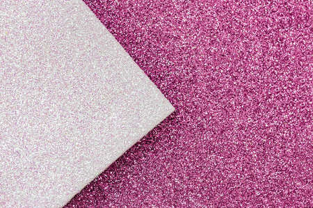 Shiny multicolored festive background. Multicolor paper diagonal background pink, white colors. Top view, copy space.