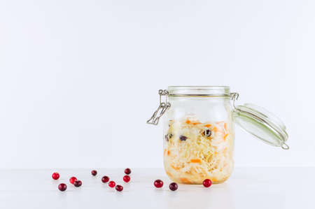 Sauerkraut in glass mason jar. Homemade sauerkraut with carrot . Fermented food. Natural probiotic. Copy space. Фото со стока