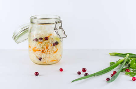 Sauerkraut in glass mason jar. Homemade sauerkraut with carrot . Fermented food. Canned food. Copy space. Фото со стока