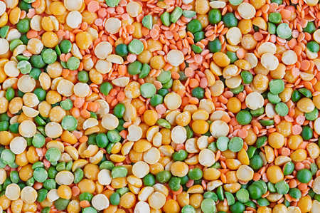 Dried peas and lentils close-up. Background from a mixture of legumes. Top view.