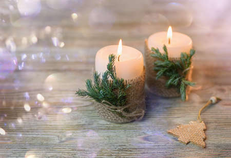 Christmas background with candles. Wooden background, bokeh, selective focus. Close up. Фото со стока