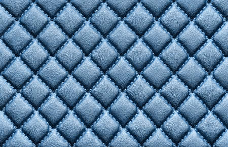 Faux leather with embossed blue color. Background texture, top view. Close up. Фото со стока