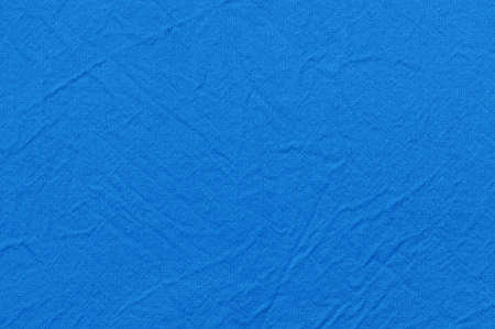 Natural linen texture for the background colored in blue color. Top view. Фото со стока