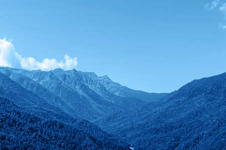 Amazing mountain landscape toned blue. Natural outdoor travel background.