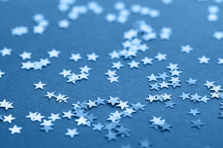 Blue glitter background. Sparkling festive backdrop for design. Selective focus. Фото со стока