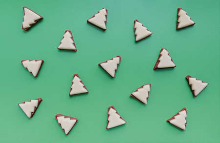 Pattern of chocolate Christmas trees. Minimalistic christmas background. Flat lay. Copy spase. Top view. Фото со стока