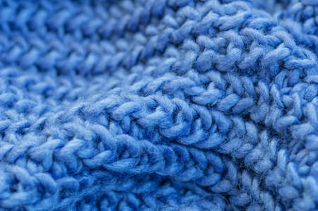 Blue knitted fabric closeup. Knitted wool background. Handmade. Close up.