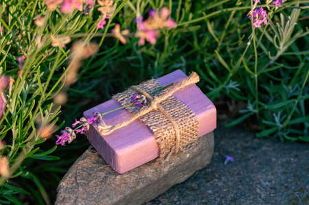 Handmade soap on a background of blooming lavender. Floral background.
