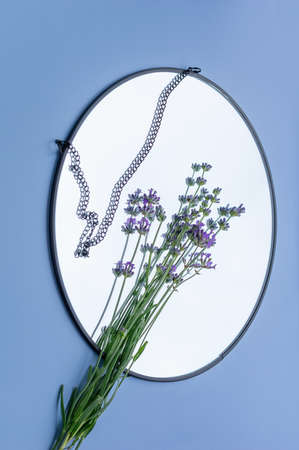 Blooming lavender with reflection in the mirror. Vertical crop.