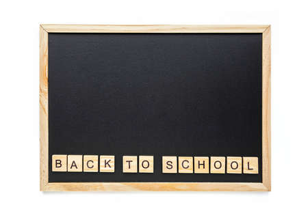 Back to school words lettering on the school black chalkboard. Education, back to school concept, top view, flat lay. Copy space.