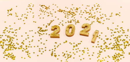 Happy New 2021 Year. Gold numbers 2021 and stars on a light background. Copy space. Фото со стока