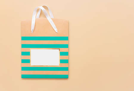 Shopping bag on beige background. Minimal concept. Flat lay, top view. Copy space. Close up.