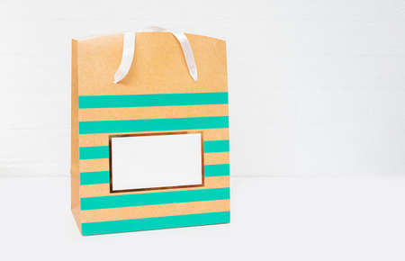 Shopping bag on white background. Minimal concept. Copy space. Close up.