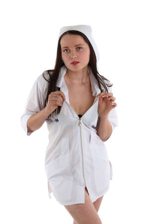 sexy nurse with stethoscope on white background photo