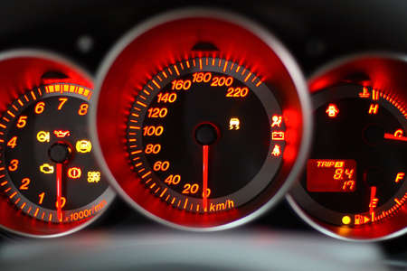 rev: car panel instrument red speedometer and tachometer