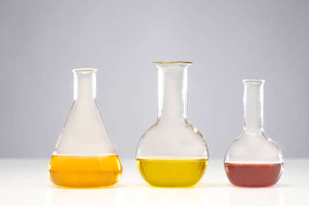 Glass flasks. The concept is drug development. The medicine. Glass flasks. Medical laboratory. The creation of an antidote. Beakers with multi-colored liquids. The creation of drugs. Pharmacology.