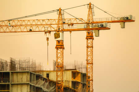Construction cranes. Construction of a multi-storey building. Construction cranes against the sky.