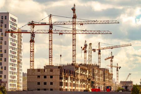 Construction of multi-storey houses. Construction cranes. Construction site. Stock fotó