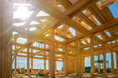 House made of laminated veneer lumber. The frame of the house. Construction of cottages. Under construction cottage.
