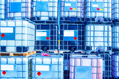 Plastic barrels. A wall of barrels for the chemical industry. Containers for chemical liquids.