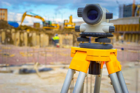 Construction site. Geodesy. Optical level. Electronic theodolite.