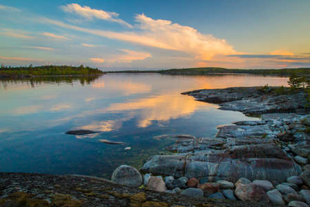 Morning in Karelia. White nights on Lake Ladoga. Reflection of clouds in the Ladoga Lake. The Republic of Karelia. Northern nature. Russia. Nature of Russia.