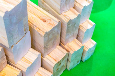 Wooden beams. Construction Materials. A beam for building a house. Glued timber. Materials for the construction of the house.