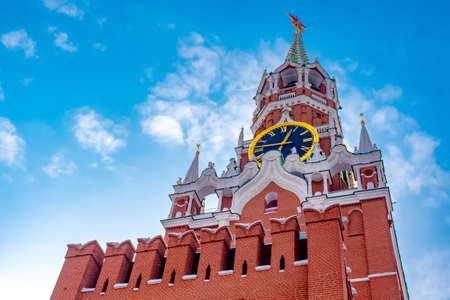 Moscow. Russia. The Red Square. Kremlin. Spasskaya Tower. Russian Federation. Travel to Russia. Hours on Red Square. Chimes on the Spassky Tower. Center of Russia. Kremlin walls. Фото со стока
