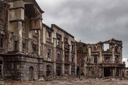 Post-war landscape. Destroyed building. War ruins. Destroyed city after the bombing. Dead city. Bombed buildings. Debris buildings. War destruction.