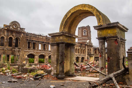 Broken city after the war. Ruins of war. Destroyed city after a military attack. The bombed-out buildings. The wreckage of buildings. War destruction.