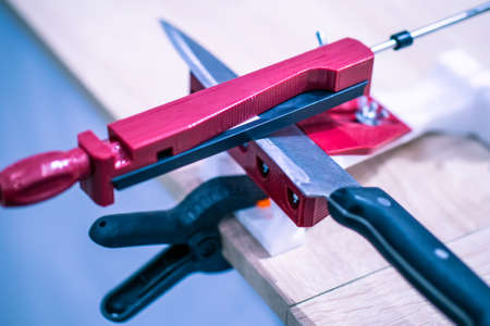 Knife grinder. Knife sharpener. Tool for sharpening knives. Kitchen appliance. 免版税图像