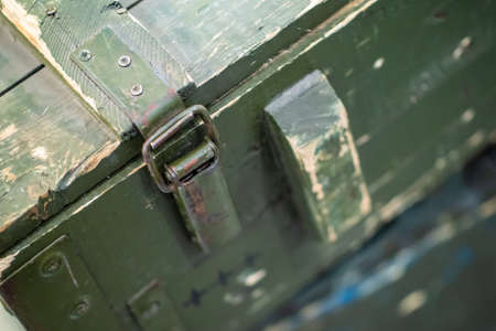 Old army crate. The lock on the military box. Storage of military equipment and weapons. Army ammunition.
