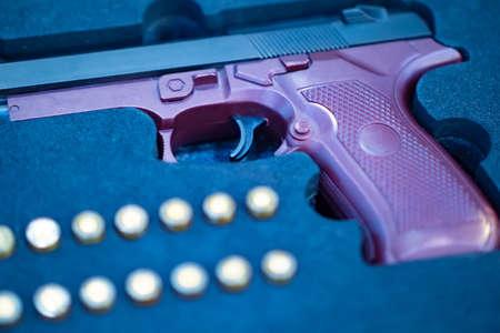 Pistol with cartridges in the case. Firearms. Gun for self defense. Zdjęcie Seryjne