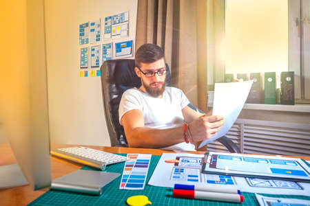 Artist Creative Designer Illustrator Graphic Skill Concept. Male graphic designer at the desk. Design for mobile devices. Standard-Bild