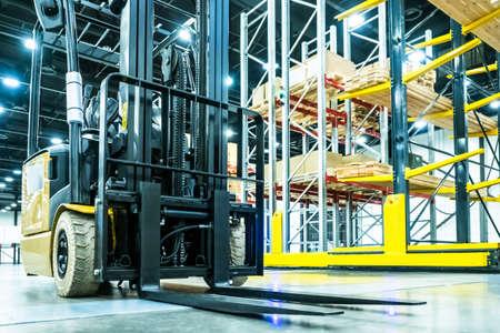 Forklift truck Stock. Loading goods. Cargo storage. Logistics. Forklift on the background of racks. Shelves in stock. Tiered shelving.