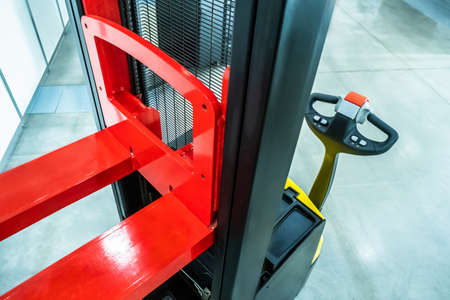 Hydraulic trolley. Trolley for pallets. Lifting equipment. Hand pallet truck. Warehouse equipment. Transportation of goods in stock. Hydraulic trolley for the store.