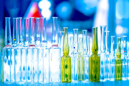 Laboratory glassware. Chemical test tubes. Medical glass flasks. Analysis of the composition of substances. Laboratory research. Chemical industry. Medicines. Pharmacology.