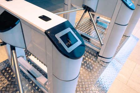 Turnstile at the entrance. Electronic turnstile. Turnstile spinner. Control at the entrance. Identifying people at the entrance. Security in the enterprise. Stock Photo